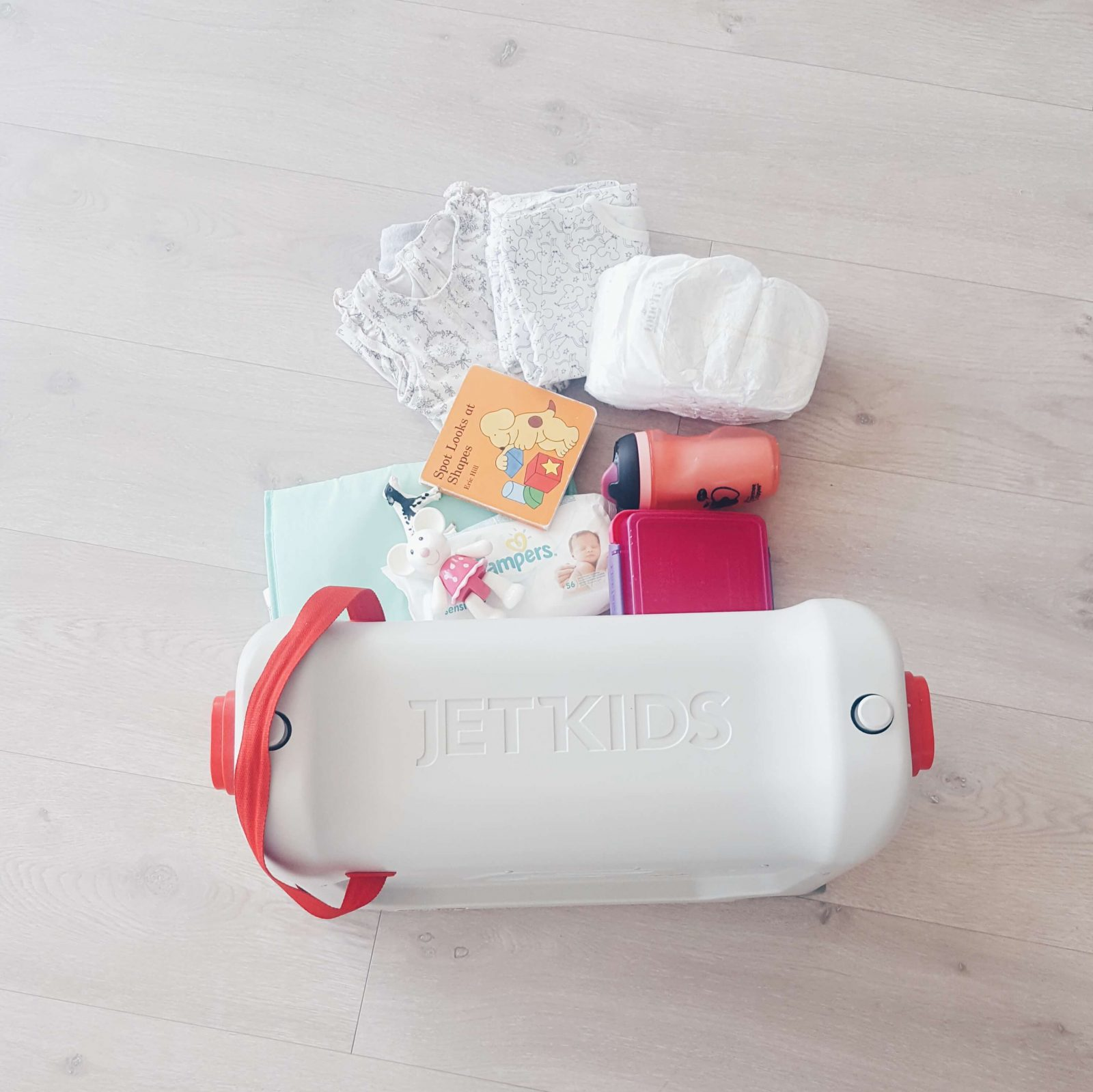 flatlay of items by bedbox